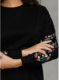 evening dress with sheer sleeves