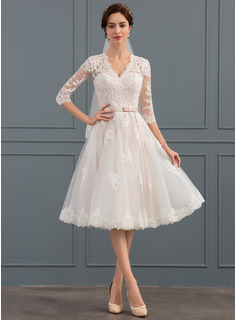 A-Line V-neck Knee-Length Tulle Wedding Dress With Bow(s)